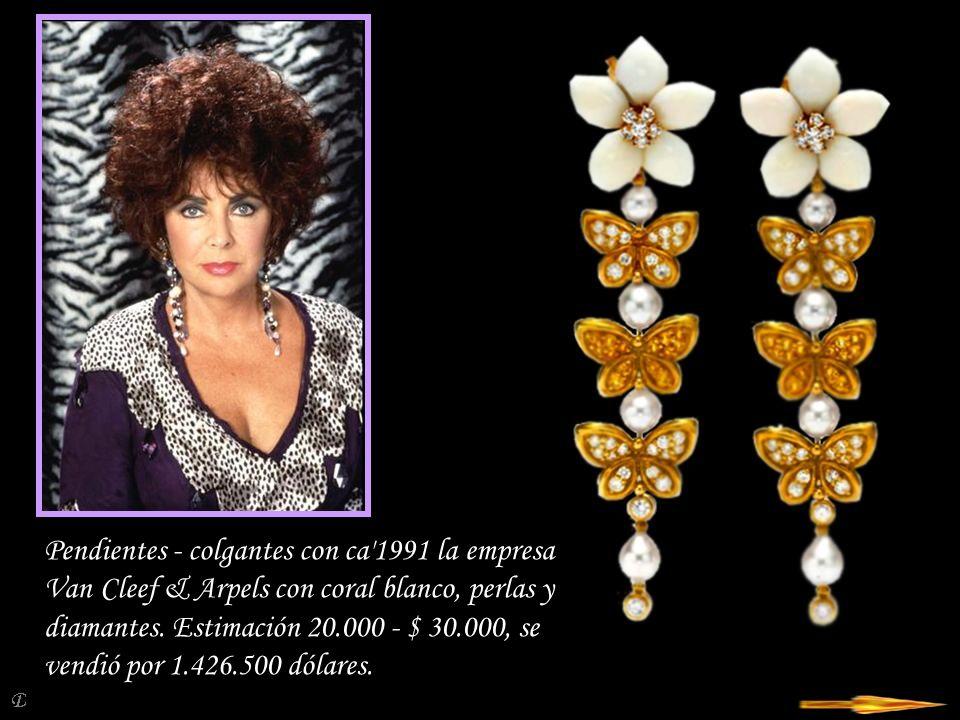 Da - Ma El anillo con un diamante de color amarillo brillante de pesaje 27,42 ct en los lados dos diamantes blancos triangulares.