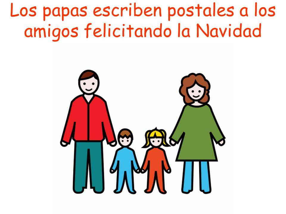 Los papas escriben postales a los amigos felicitando la Navidad