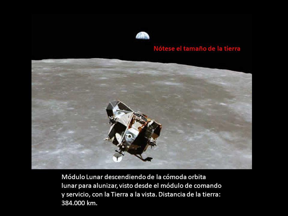 Módulo Lunar descendiendo de la cómoda orbita lunar para alunizar, visto desde el módulo de comando y servicio, con la Tierra a la vista. Distancia de