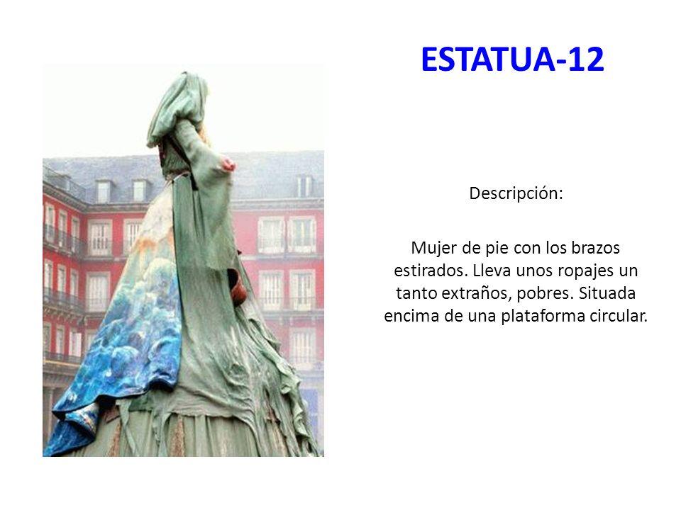 ESTATUA-12 Descripción: Mujer de pie con los brazos estirados. Lleva unos ropajes un tanto extraños, pobres. Situada encima de una plataforma circular
