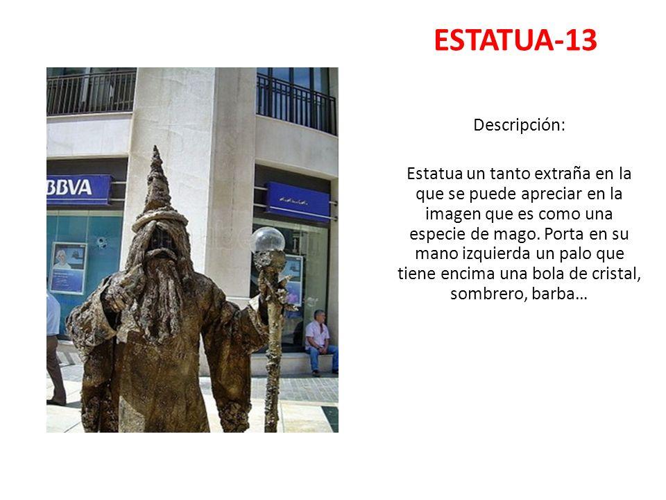 ESTATUA-13 Descripción: Estatua un tanto extraña en la que se puede apreciar en la imagen que es como una especie de mago. Porta en su mano izquierda