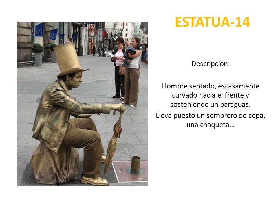 ESTATUA-14 Descripción: Hombre sentado, escasamente curvado hacia el frente y sosteniendo un paraguas. Lleva puesto un sombrero de copa, una chaqueta…