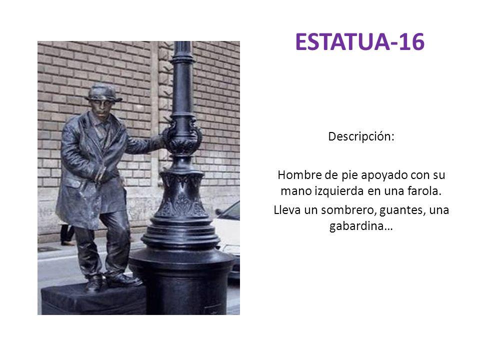 ESTATUA-16 Descripción: Hombre de pie apoyado con su mano izquierda en una farola. Lleva un sombrero, guantes, una gabardina…