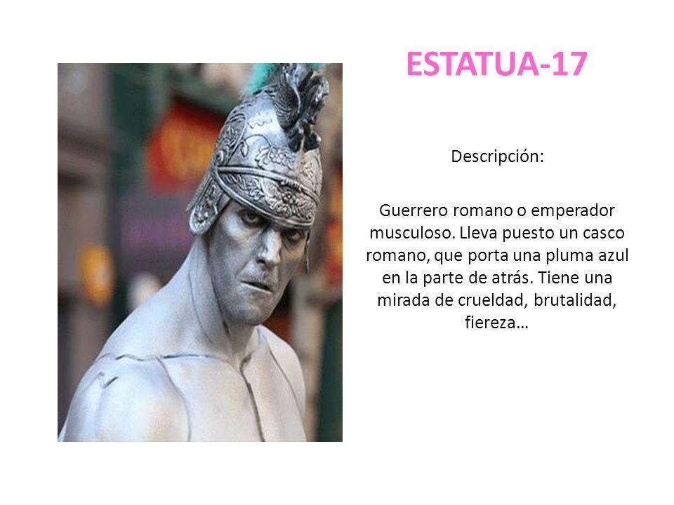 ESTATUA-17 Descripción: Guerrero romano o emperador musculoso. Lleva puesto un casco romano, que porta una pluma azul en la parte de atrás. Tiene una