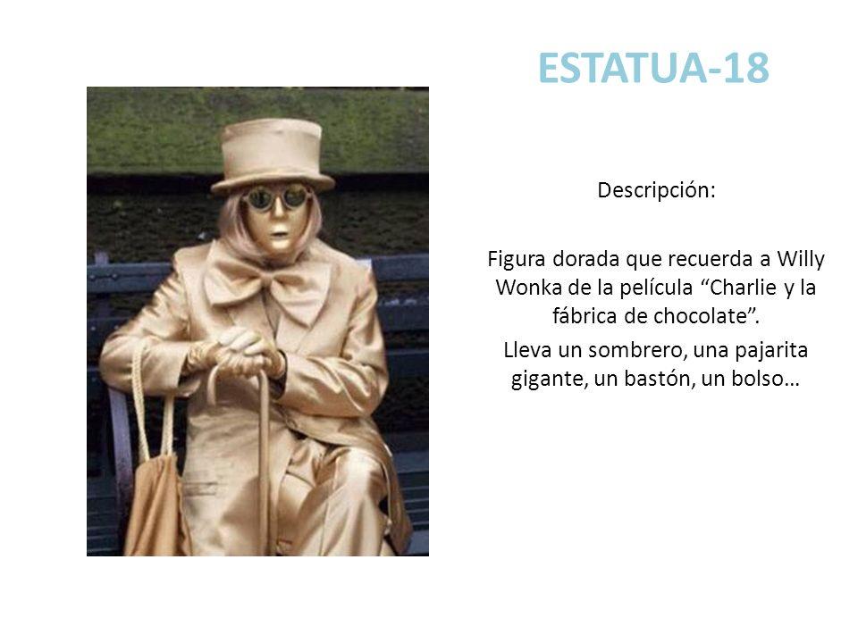 ESTATUA-18 Descripción: Figura dorada que recuerda a Willy Wonka de la película Charlie y la fábrica de chocolate. Lleva un sombrero, una pajarita gig