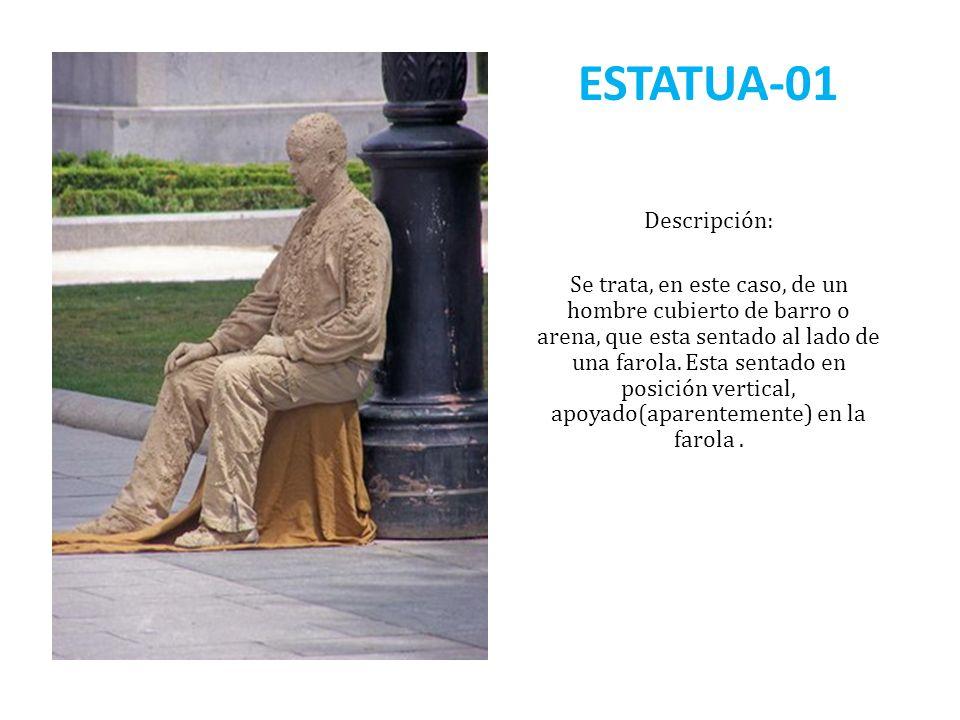 ESTATUA-01 Descripción: Se trata, en este caso, de un hombre cubierto de barro o arena, que esta sentado al lado de una farola. Esta sentado en posici