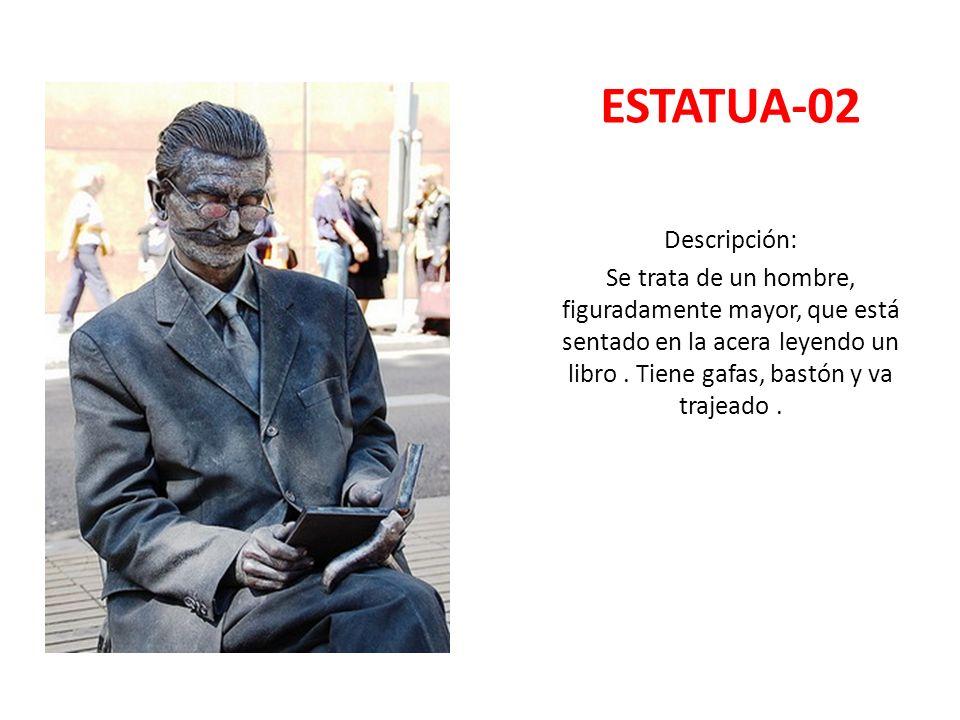 ESTATUA-02 Descripción: Se trata de un hombre, figuradamente mayor, que está sentado en la acera leyendo un libro. Tiene gafas, bastón y va trajeado.