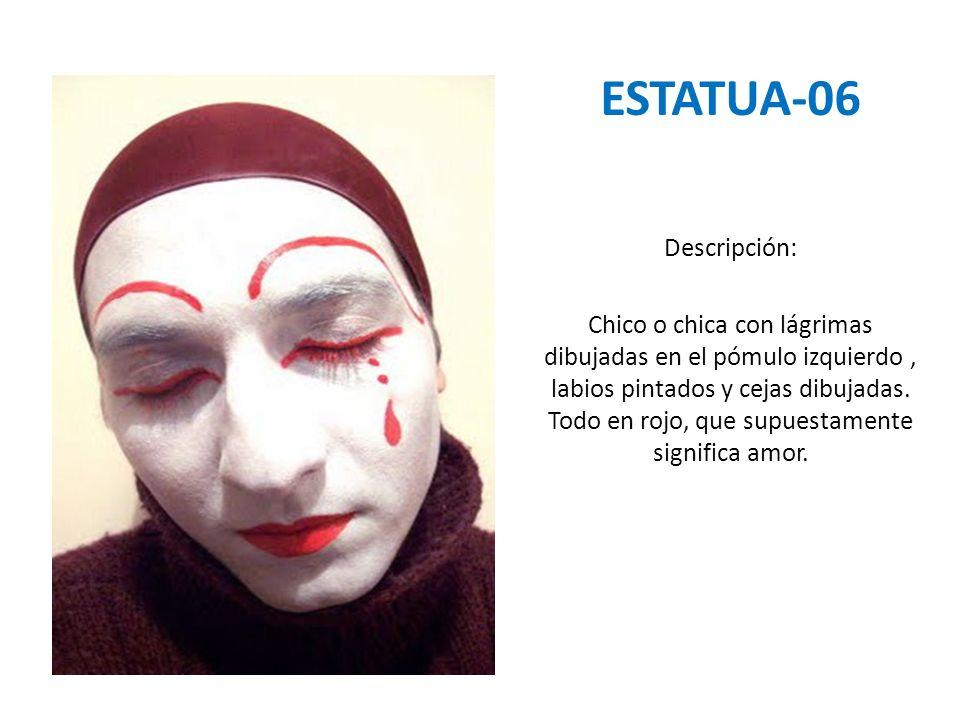 ESTATUA-06 Descripción: Chico o chica con lágrimas dibujadas en el pómulo izquierdo, labios pintados y cejas dibujadas. Todo en rojo, que supuestament