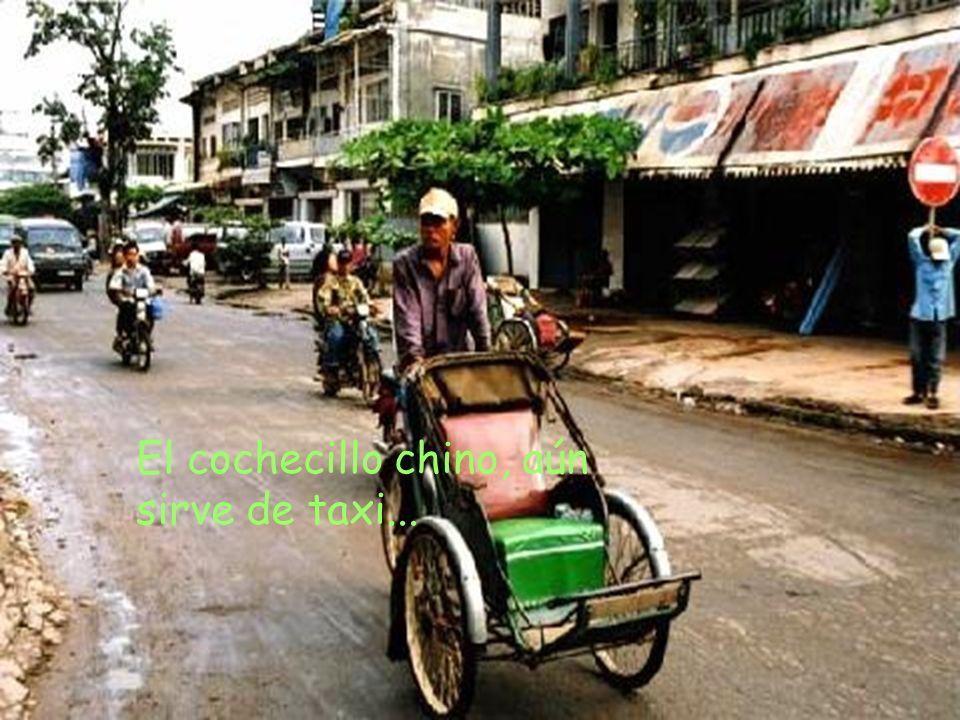 El cochecillo chino, aún sirve de taxi...