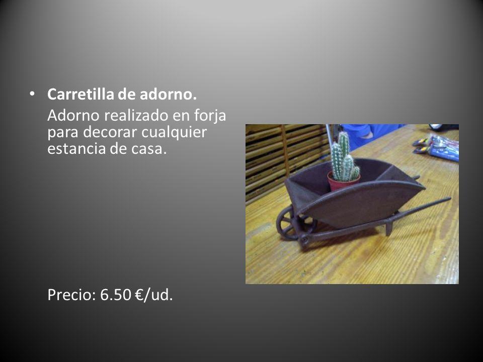 Carretilla de adorno. Adorno realizado en forja para decorar cualquier estancia de casa. Precio: 6.50 /ud.