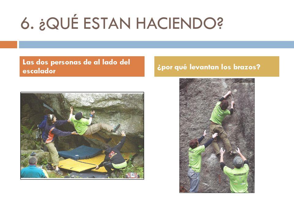 6. ¿QUÉ ESTAN HACIENDO Las dos personas de al lado del escalador ¿por qué levantan los brazos