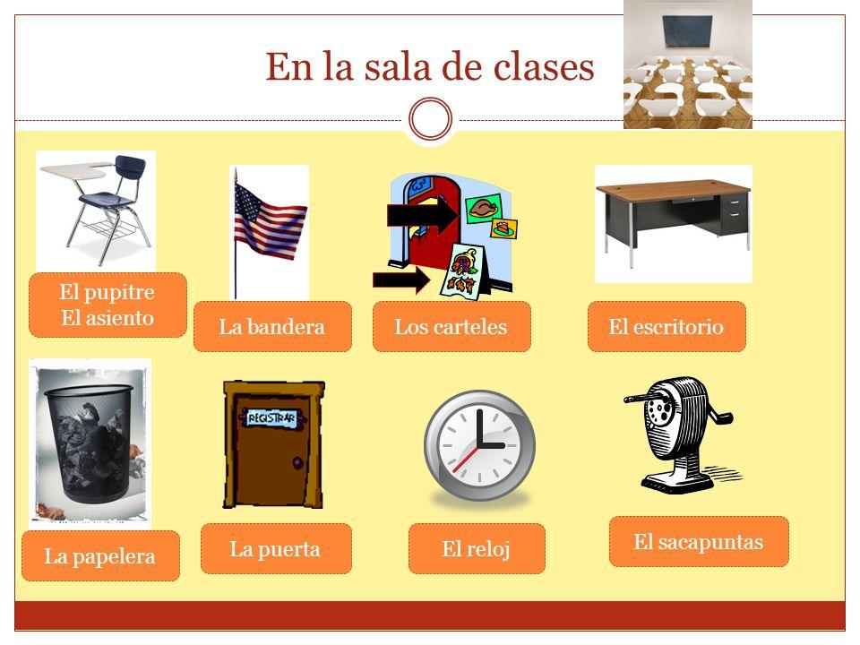 En la sala de clases El pupitre El asiento La banderaLos cartelesEl escritorio La papelera La puertaEl reloj El sacapuntas