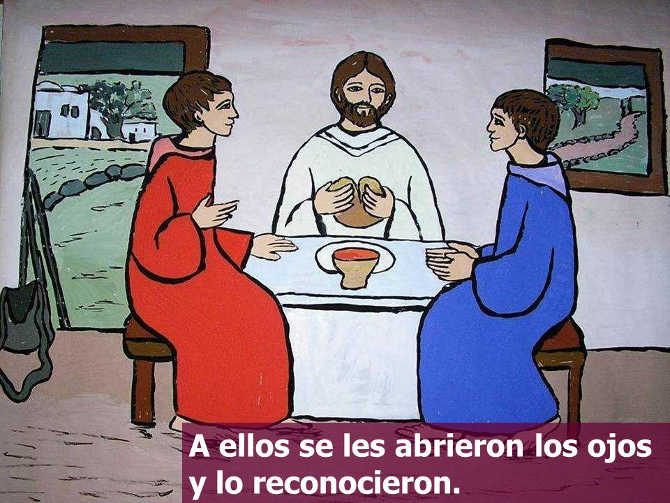 Sentado a la mesa tomó el pan, pronunció la bendición, lo partió y se lo dio.