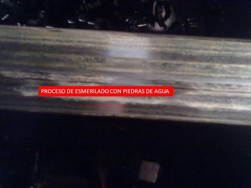 PROCESO DE ESMERILADO CON PIEDRAS DE AGUA
