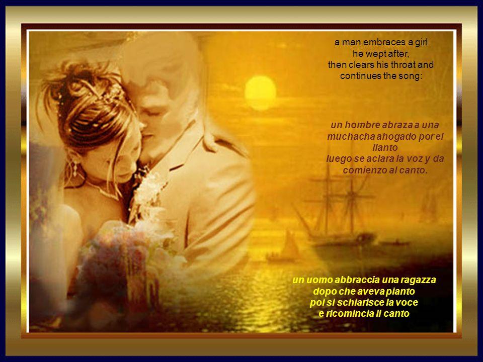 un uomo abbraccia una ragazza dopo che aveva pianto poi si schiarisce la voce e ricomincia il canto a man embraces a girl he wept after, then clears his throat and continues the song: un hombre abraza a una muchacha ahogado por el llanto luego se aclara la voz y da comienzo al canto.