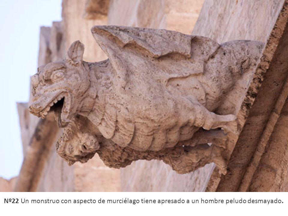 Nº22 Un monstruo con aspecto de murciélago tiene apresado a un hombre peludo desmayado.