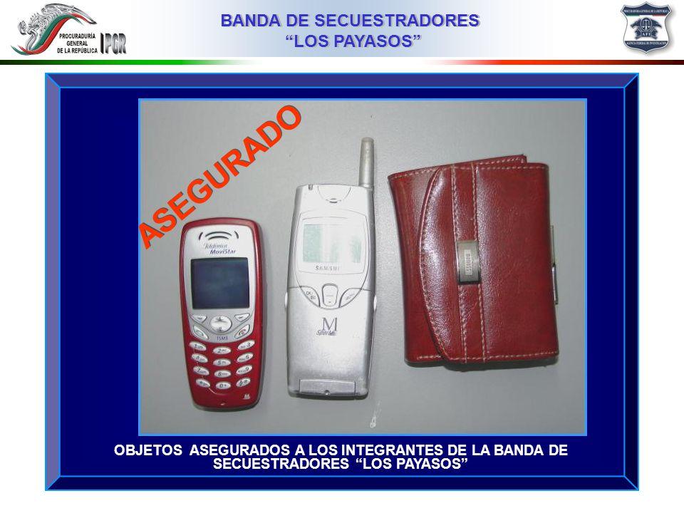 03MMIII BANDA DE SECUESTRADORES LOS PAYASOS BANDA DE SECUESTRADORES LOS PAYASOS VEHÍCULO VOLKSWAGEN, COLOR ROJO, CON PLACAS DE CIRCULACIÓN 384PFR, DEL DISTRITO FEDERAL, UTILIZADO POR LOS SECUESTRADORES, PROPIEDAD DE JOSÉ LUIS RUIZ MONDRAGON ASEGURADO
