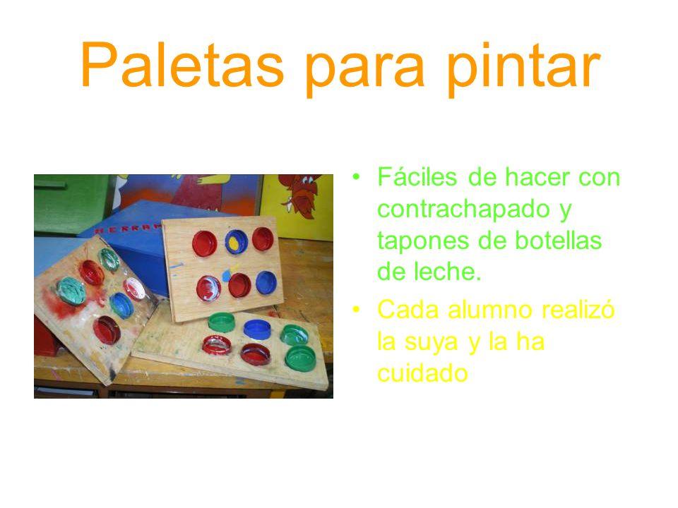 Paletas para pintar Fáciles de hacer con contrachapado y tapones de botellas de leche. Cada alumno realizó la suya y la ha cuidado