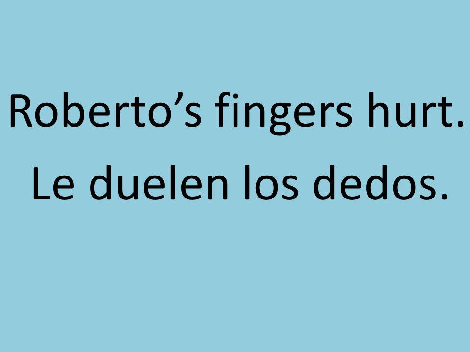 Robertos fingers hurt. Le duelen los dedos.