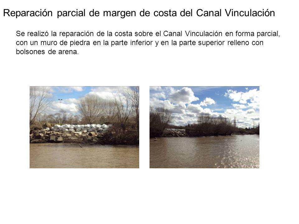 Reparación parcial de margen de costa del Canal Vinculación Se realizó la reparación de la costa sobre el Canal Vinculación en forma parcial, con un muro de piedra en la parte inferior y en la parte superior relleno con bolsones de arena.