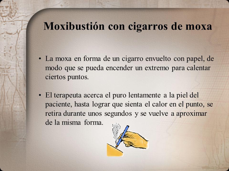 Moxibustión con cigarros de moxa La moxa en forma de un cigarro envuelto con papel, de modo que se pueda encender un extremo para calentar ciertos puntos.