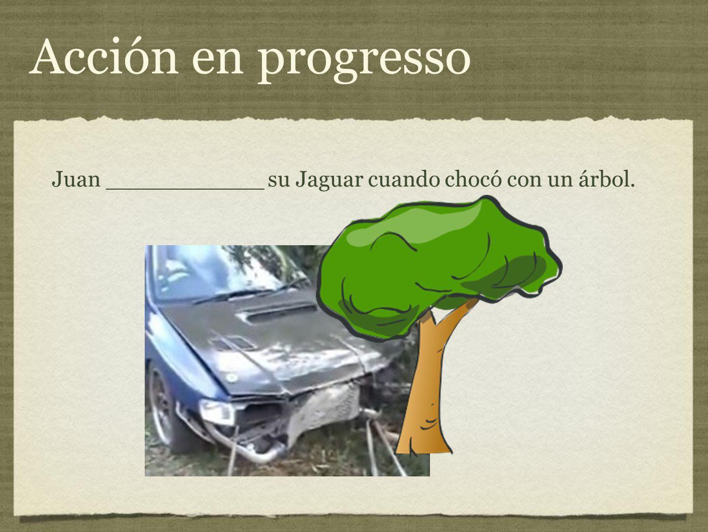 Acción en progresso Juan ___________ su Jaguar cuando chocó con un árbol.
