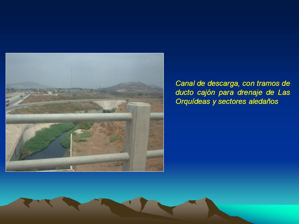 Canal de descarga, con tramos de ducto cajón para drenaje de Las Orquídeas y sectores aledaños
