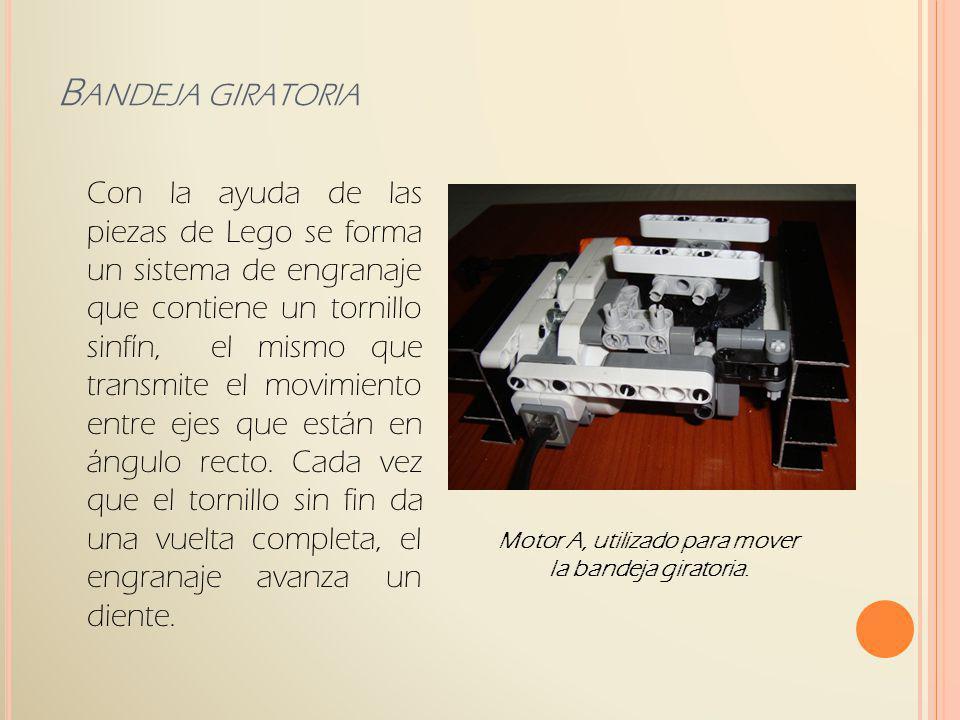 Con la ayuda de las piezas de Lego se forma un sistema de engranaje que contiene un tornillo sinfín, el mismo que transmite el movimiento entre ejes q