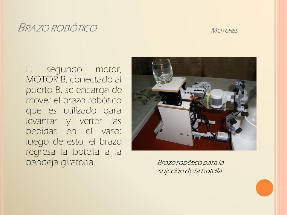 El Motor B se encuentra acoplado mediante las partes de Lego y soportadas a una base de madera, elevada a 19 cm, para estar al nivel del cuello de las botellas.
