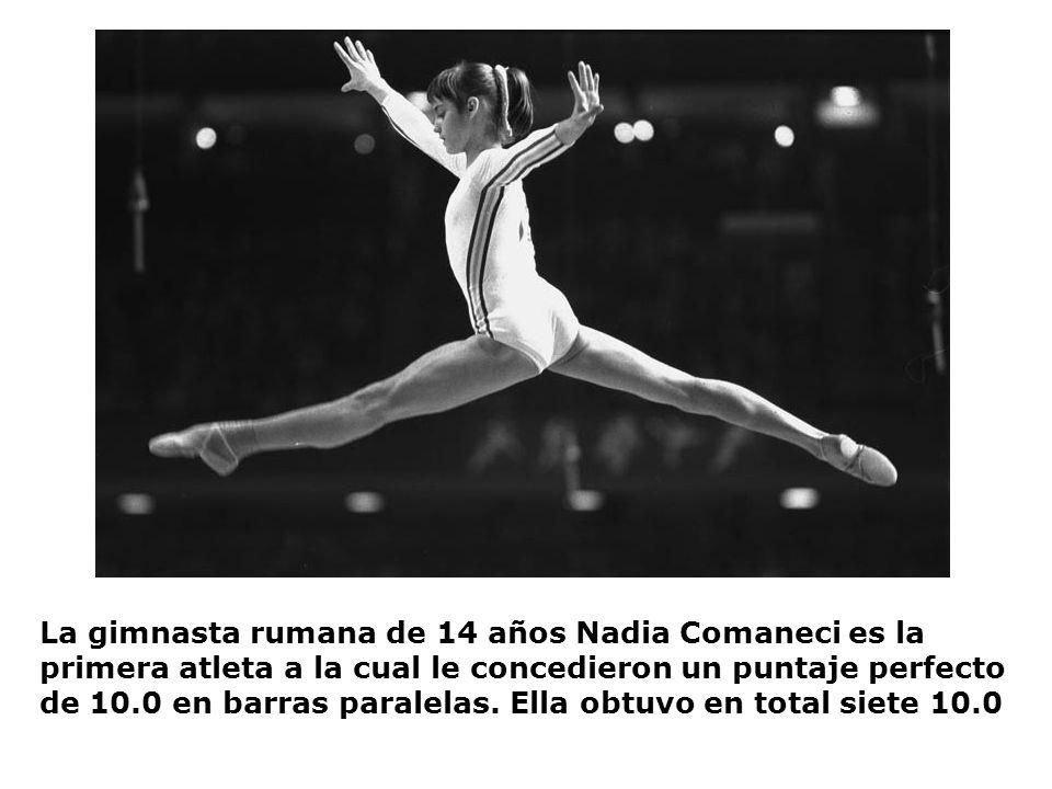 La gimnasta rumana de 14 años Nadia Comaneci es la primera atleta a la cual le concedieron un puntaje perfecto de 10.0 en barras paralelas. Ella obtuv