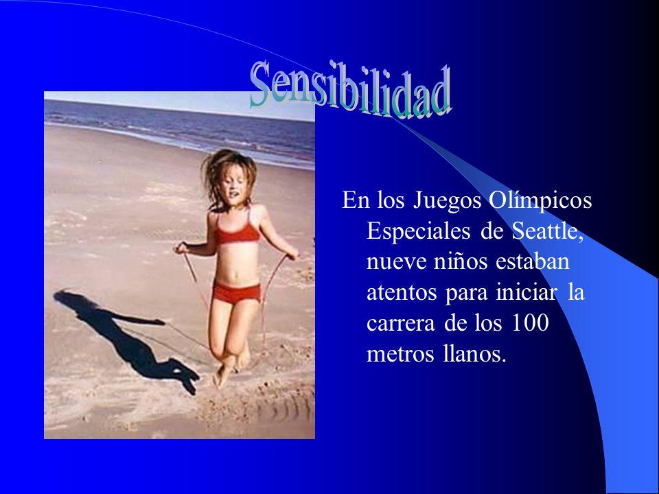 En los Juegos Olímpicos Especiales de Seattle, nueve niños estaban atentos para iniciar la carrera de los 100 metros llanos.