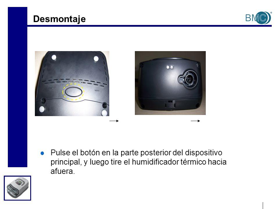 Desmontaje Pulse el botón en la parte posterior del dispositivo principal, y luego tire el humidificador térmico hacia afuera.