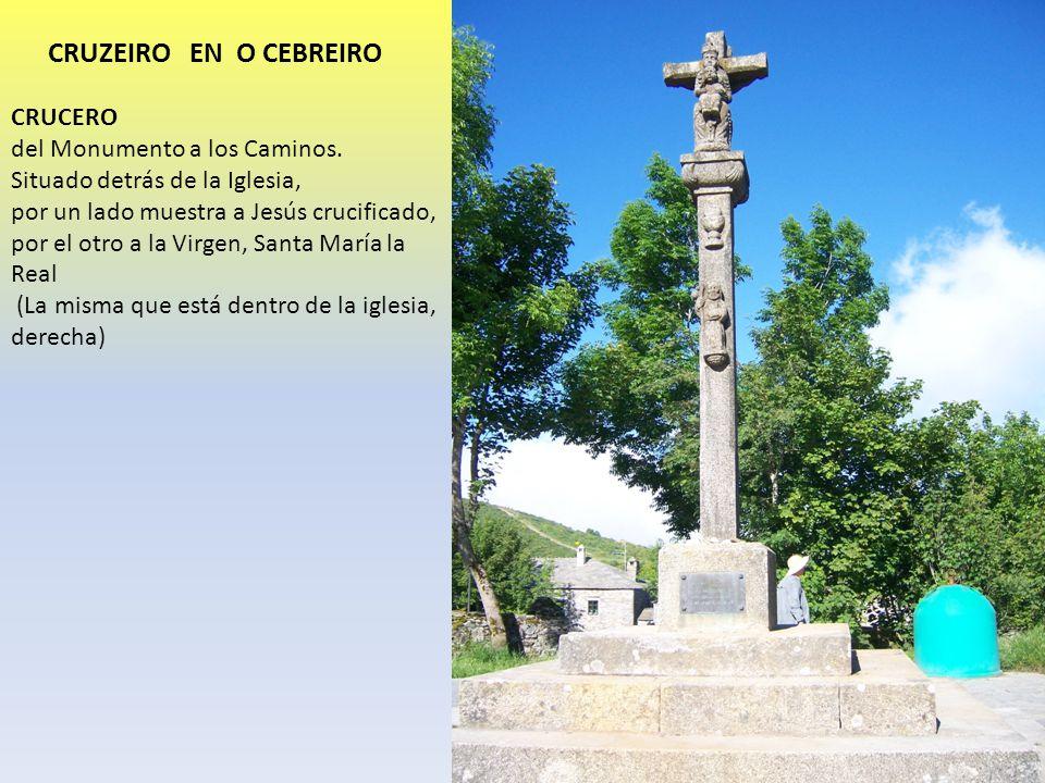 CRUZEIRO EN O CEBREIRO CRUCERO del Monumento a los Caminos. Situado detrás de la Iglesia, por un lado muestra a Jesús crucificado, por el otro a la Vi