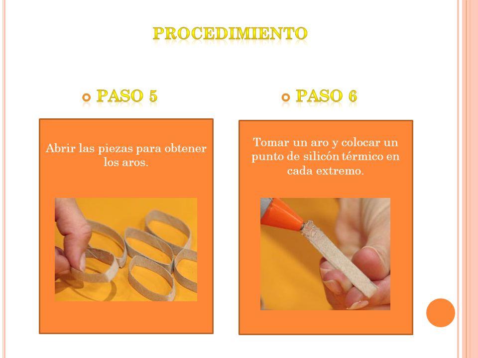 Abrir las piezas para obtener los aros. Tomar un aro y colocar un punto de silicón térmico en cada extremo.
