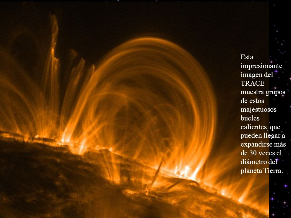 Esta impresionante imagen del TRACE muestra grupos de estos majestuosos bucles calientes, que pueden llegar a expandirse más de 30 veces el diámetro d